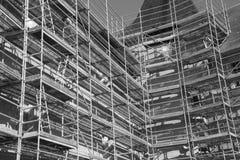 Iron construction scaffolding. Building facade white black photo royalty free stock image