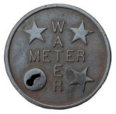 Iron cover for neighborhood water meter Royalty Free Stock Photography