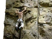 Iron Cross. Indoor rock climbing wall stock image