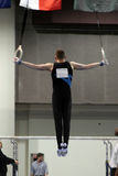 Iron cross. Gymnast competing on rings Royalty Free Stock Photos