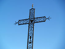 An iron cross against a blue sky, Chusclan, France. Christian cross against a blue sky in Chusclan, south of France Royalty Free Stock Photography