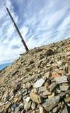 The iron cross called cruz de Hierro along the way of St. James, Spain. Stock Image
