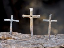 Iron Cross Display. Hand crafted iron cross displayed in a blacksmith shop. Backgrounds in blur to set off its holy feeling stock image