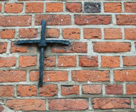 Iron cross. Medieval solution of fixing the wooden beams to the exterior massive brick walls. Resembles an iron cross Stock Photos