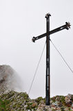 Iron cross on misty mountain, Pilatus, Switzerland Royalty Free Stock Photos