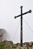 Iron cross on misty mountain, Pilatus, Switzerland Royalty Free Stock Photos