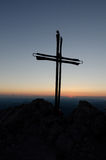 Iron cross on a mountain and the last rays of the  Royalty Free Stock Photo
