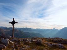 Iron cross at mountain top in alp. Monument to the dead climbers Royalty Free Stock Image