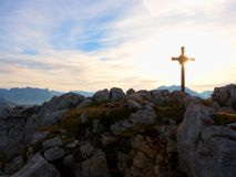 Iron cross at mountain top in alp. Monument to the dead climbers Stock Image