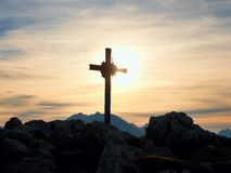 Iron cross at mountain top in alp. Monument to the dead climbers Stock Photos