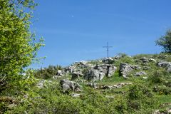 An Iron Cross In A Mountain Trail.  royalty free stock photo