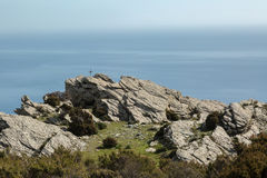 Iron cross in the mountains on the east coast of Corsica Stock Photo