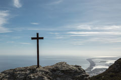 Iron cross in the mountains on the east coast of Corsica Stock Photography