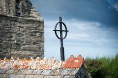Iron cross. On the roof gable of St Enodoc Curch near Daymer bay in north Cornwall royalty free stock photos