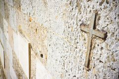 Iron cross snuggled in stone with copy space.  Stock Photo