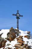Iron cross in Alps. Iron cross on the top of the Gaislachkogl mountain near Solden in the Zillertal Alps in Austria royalty free stock photography