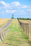 Iron curtain and watchtower with patrol road in former Czechoslo Royalty Free Stock Photography