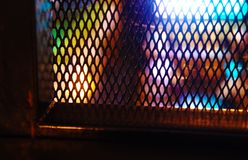 Iron decorative mesh in the cafe, loft dyeing, city lights stock photo