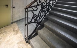 Staircase, staircase in a modern house. Iron decorative railings. Iron decorative railings. Staircase, staircase in a modern house stock photo