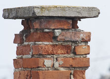 The iron dent of time. Old chimney of the old house Stock Photography
