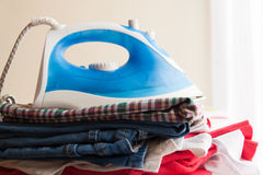 Iron  with different clothes Royalty Free Stock Photography