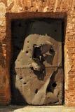 Iron door. Brick wall and iron door Royalty Free Stock Photos