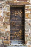 Iron door. Ancient iron door with decor and handle elements stock photo