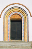 Iron door in the arch painted ornament Stock Images