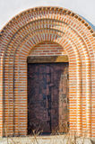 Iron door in the arch painted ornament Royalty Free Stock Photo