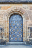Iron door. Of the church Stock Photography