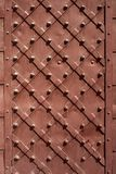 Iron door closeup for texture or background, vintage style, brown color stock image