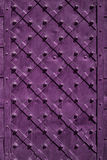 Iron door closeup for texture or background, vintage style, purple color stock image