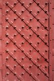 Iron door closeup for texture or background, vintage style, red color royalty free stock images