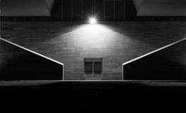 Iron door in a dark alley. Black and white Royalty Free Stock Photo