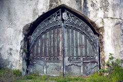 Iron door gate in the wall Royalty Free Stock Photography