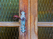 Iron door handle on old wooden door Stock Photography