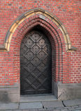 The iron door in the old red block wall Royalty Free Stock Photography