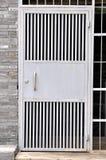 Iron door in plain style Stock Images