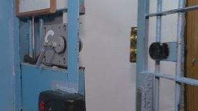 The iron door in prison. Closeup of the chamber slamming the door to close the cage with iron bars stock video footage