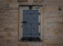 The iron door in a stone wall Stock Image