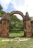 Iron door and stone walls of colonial coffe plantation. Ancient Angerona coffee plantation, now in ruins, in Artemisa province, Cuba, surrounded by a fantastic Stock Image