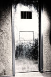 Iron door to the prison cell with a hole for food and window Stock Image