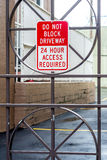 Iron door with warning. Do not block. Royalty Free Stock Photography