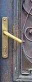 The iron doorhandle on the  doors. The iron doorhandle on the wooden doors Royalty Free Stock Photos