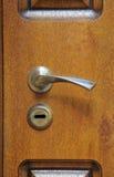 The iron doorhandle. On the wooden doors Stock Photo