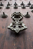 Iron Doorknocker on Wooden Door Royalty Free Stock Images