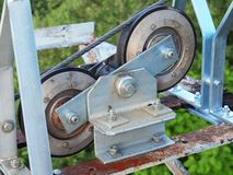 Free Iron Double Pulley With Hard Rubber Inserts, Steel Rope Of Cable Way. Galvanized Iron Construction Royalty Free Stock Photography - 41431817