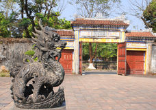 Iron dragon statue and entrance gate in Imperial palace, Hue, Vi Royalty Free Stock Photos