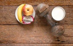 Iron dumbbell and  milk with fruit (banana,appke,dragon fruit) o Stock Photo