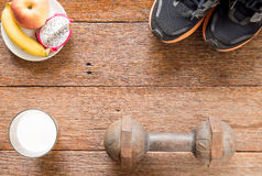 Iron dumbbell,Sports shoes and  milk with fruit (banana,appke,dr Royalty Free Stock Images